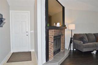 Photo 5: 220 DUNLUCE RD NW: Edmonton House for sale : MLS®# E4054042