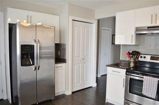 Photo 11: 220 DUNLUCE RD NW: Edmonton House for sale : MLS®# E4054042