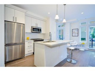 "Photo 2: 3711 COMMERCIAL Street in Vancouver: Victoria VE Townhouse for sale in ""O2"" (Vancouver East)  : MLS®# V1025256"