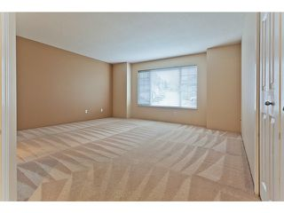 Photo 8: # 103 1685 PINETREE WY in Coquitlam: Westwood Plateau Townhouse for sale : MLS®# V1036037