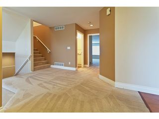 Photo 4: # 103 1685 PINETREE WY in Coquitlam: Westwood Plateau Townhouse for sale : MLS®# V1036037