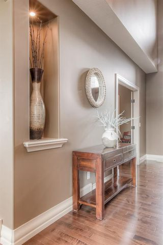 Photo 4: 121 ROCKCLIFF Bay NW in Calgary: Rocky Ridge Detached for sale : MLS®# A1015213