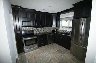 Photo 12: 719 75 Avenue SW in Calgary: Kingsland Detached for sale : MLS®# A1039332