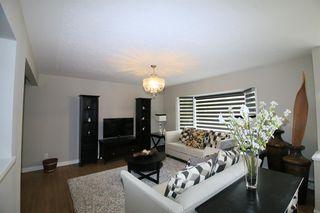 Photo 7: 719 75 Avenue SW in Calgary: Kingsland Detached for sale : MLS®# A1039332