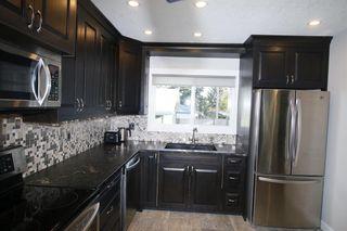 Photo 11: 719 75 Avenue SW in Calgary: Kingsland Detached for sale : MLS®# A1039332
