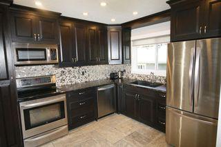 Photo 10: 719 75 Avenue SW in Calgary: Kingsland Detached for sale : MLS®# A1039332