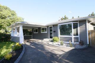 Photo 4: 719 75 Avenue SW in Calgary: Kingsland Detached for sale : MLS®# A1039332