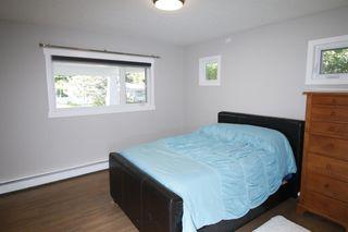 Photo 17: 719 75 Avenue SW in Calgary: Kingsland Detached for sale : MLS®# A1039332