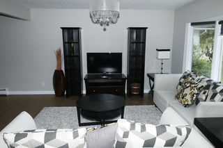 Photo 8: 719 75 Avenue SW in Calgary: Kingsland Detached for sale : MLS®# A1039332