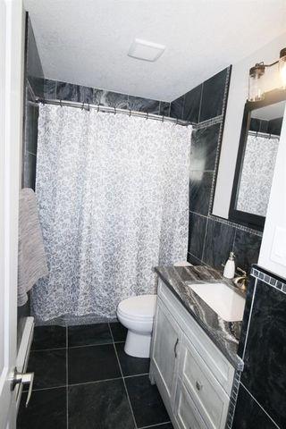 Photo 20: 719 75 Avenue SW in Calgary: Kingsland Detached for sale : MLS®# A1039332