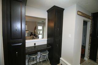 Photo 13: 719 75 Avenue SW in Calgary: Kingsland Detached for sale : MLS®# A1039332