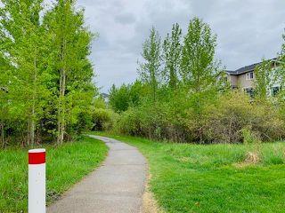 Photo 4: 12485 CRESTMONT Boulevard SW in Calgary: Crestmont Detached for sale : MLS®# C4285011