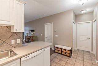 Photo 5: 1204 LAKE FRASER Green SE in Calgary: Lake Bonavista Apartment for sale : MLS®# A1035859