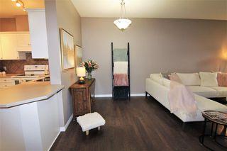 Photo 6: 1204 LAKE FRASER Green SE in Calgary: Lake Bonavista Apartment for sale : MLS®# A1035859