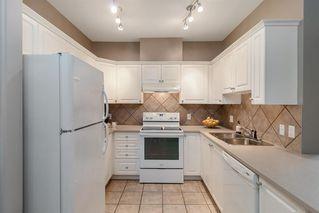 Photo 3: 1204 LAKE FRASER Green SE in Calgary: Lake Bonavista Apartment for sale : MLS®# A1035859