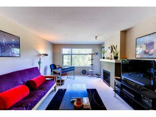 "Photo 2: 302 300 KLAHANIE Drive in Port Moody: Port Moody Centre Condo for sale in ""Tides"" : MLS®# V1017878"