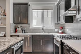 Photo 13: 1 924 3 Avenue NW in Calgary: Sunnyside Row/Townhouse for sale : MLS®# C4271137