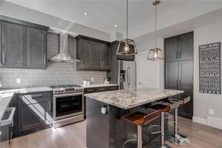 Photo 12: 1 924 3 Avenue NW in Calgary: Sunnyside Row/Townhouse for sale : MLS®# C4271137