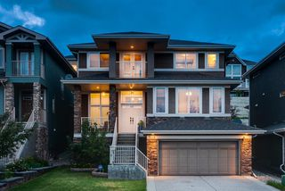 Photo 1: 7516 SPRINGBANK Way SW in Calgary: Springbank Hill Detached for sale : MLS®# A1033982