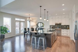 Photo 6: 7516 SPRINGBANK Way SW in Calgary: Springbank Hill Detached for sale : MLS®# A1033982
