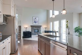 Photo 5: 7516 SPRINGBANK Way SW in Calgary: Springbank Hill Detached for sale : MLS®# A1033982