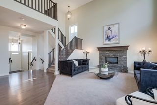 Photo 4: 7516 SPRINGBANK Way SW in Calgary: Springbank Hill Detached for sale : MLS®# A1033982