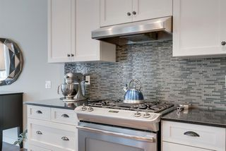 Photo 8: 7516 SPRINGBANK Way SW in Calgary: Springbank Hill Detached for sale : MLS®# A1033982