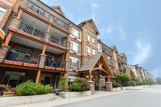 "Photo 2: 404 12565 190A Street in Pitt Meadows: Mid Meadows Condo for sale in ""Cedar Downs"" : MLS®# R2505666"