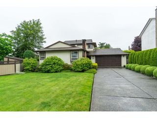 Photo 1: 8429 SPENSER Place in Surrey: Bear Creek Green Timbers House for sale : MLS®# R2464631