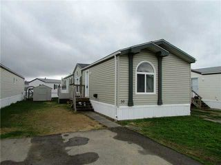 "Photo 1: 59 9203 82ND Street in Fort St. John: Fort St. John - City SE Manufactured Home for sale in ""THE COURTYARD MHP"" (Fort St. John (Zone 60))  : MLS®# N227820"