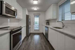 Photo 5: 306 45 ASPENMONT Heights SW in Calgary: Aspen Woods Apartment for sale : MLS®# C4267463