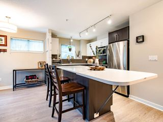"Photo 3: 207 8695 160 Street in Surrey: Fleetwood Tynehead Condo for sale in ""MONTEROSSO"" : MLS®# R2442020"