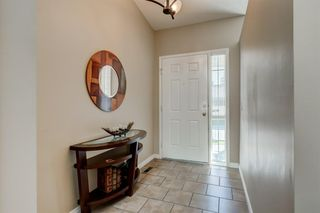 Photo 3: 8 CHRISTIE Gardens SW in Calgary: Christie Park Row/Townhouse for sale : MLS®# A1016770