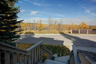 Photo 2: 55 Stratton Crescent SW in Calgary: Strathcona Park Detached for sale : MLS®# A1040233
