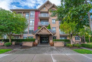 """Photo 1: 208 5811 177B Street in Surrey: Cloverdale BC Condo for sale in """"LATIS"""" (Cloverdale)  : MLS®# R2508787"""