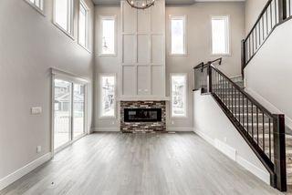 Photo 1: 7446 COLONEL MEWBURN Road in Edmonton: Zone 27 House for sale : MLS®# E4222436