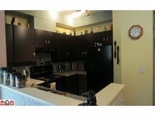 Photo 4: 101 10866 CITY Parkway in Surrey: Whalley Condo for sale (North Surrey)  : MLS®# F1225572