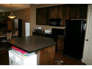 Photo 5: 191 Rainbow Falls Drive: Chestermere Townhouse for sale : MLS®# C3632294