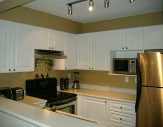 "Photo 2: 110 1190 EASTWOOD ST in Coquitlam: North Coquitlam Condo for sale in ""LAKE SIDE TERRACE"" : MLS®# V609567"