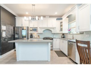"Photo 7: 7817 211B Street in Langley: Willoughby Heights Condo for sale in ""Shaughnessy Mews"" : MLS®# R2412194"