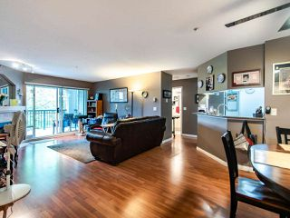 "Photo 1: 220 19528 FRASER Highway in Surrey: Cloverdale BC Condo for sale in ""FAIRMONT ON THE BOULEVARD"" (Cloverdale)  : MLS®# R2467752"