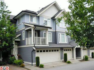 "Photo 1: 83 6575 192ND Street in Surrey: Clayton Townhouse for sale in ""IXIA"" (Cloverdale)  : MLS®# F1216748"