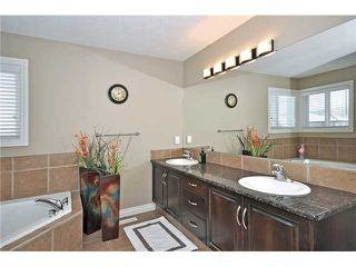 Photo 11: 14 ELMONT ESTATES Manor SW in CALGARY: Springbank Hill Residential Detached Single Family for sale (Calgary)  : MLS®# C3570379