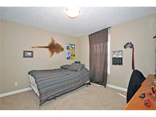 Photo 12: 14 ELMONT ESTATES Manor SW in CALGARY: Springbank Hill Residential Detached Single Family for sale (Calgary)  : MLS®# C3570379