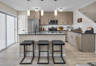 Photo 2: 7268 EDGEMONT Way in Edmonton: Zone 57 House Half Duplex for sale : MLS®# E4172630
