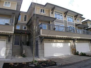 "Photo 1: 40 40632 GOVERNMENT Road in Squamish: Brackendale Townhouse for sale in ""RIVERSWALK"" : MLS®# V996205"