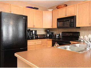 Photo 5: 543 STONEGATE Way NW: Airdrie Residential Attached for sale : MLS®# C3580927