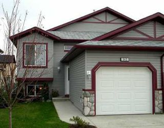 Photo 1: 543 STONEGATE Way NW: Airdrie Residential Attached for sale : MLS®# C3580927