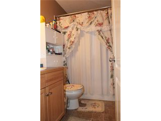 Photo 9: 543 STONEGATE Way NW: Airdrie Residential Attached for sale : MLS®# C3580927