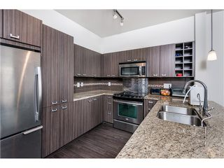 Photo 1: # 101 709 TWELFTH ST in New Westminster: Moody Park Condo for sale : MLS®# V1119632